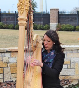 Haley Hodson playing the harp.
