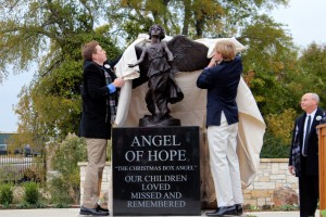 Ben and Hunter unveiling our Angel.