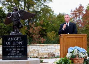 Guy McLain speaking at the dedication.